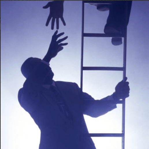 Man helping another man up a ladder