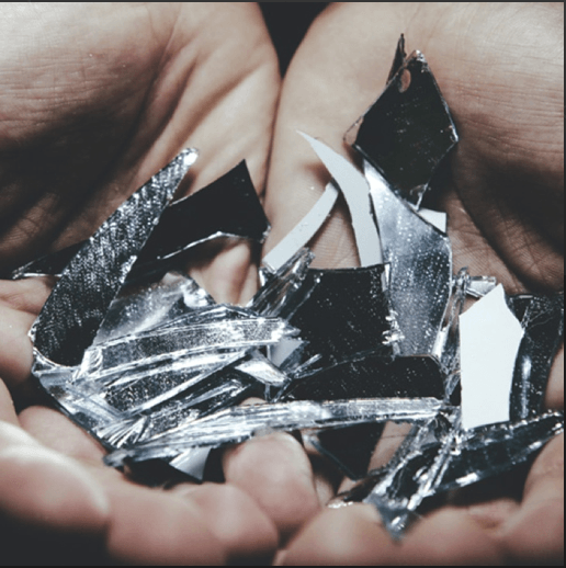 Shattered pieces of glass mirror