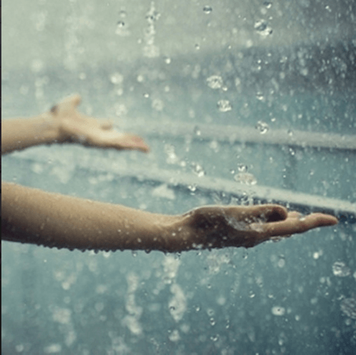 Hands catching rain